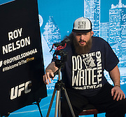 DALLAS, TX - MARCH 12:  Roy Nelson films himself during the UFC 185 Ultimate Media Day at the American Airlines Center on March 12, 2015 in Dallas, Texas. (Photo by Cooper Neill/Zuffa LLC/Zuffa LLC via Getty Images) *** Local Caption *** Roy Nelson