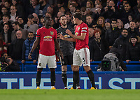 Football - 2019 / 2020 Premier League - Chelsea vs. Manchester United<br /> <br /> After soaking up a lot of early pressure Harry Maguire (Manchester United) explains to Eric Bailly (Manchester United) and David De Gea (Manchester United) a few things at Stamford Bridge <br /> <br /> COLORSPORT/DANIEL BEARHAM