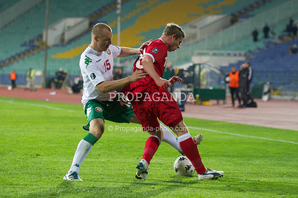 SOFIA, BULGARIA - Tuesday, October 11, 2011: Wales' Simon Church in action against Bulgaria's Ivan Ivanov during the UEFA Euro 2012 Qualifying Group G match at the Vasil Levski National Stadium. (Pic by David Rawcliffe/Propaganda)