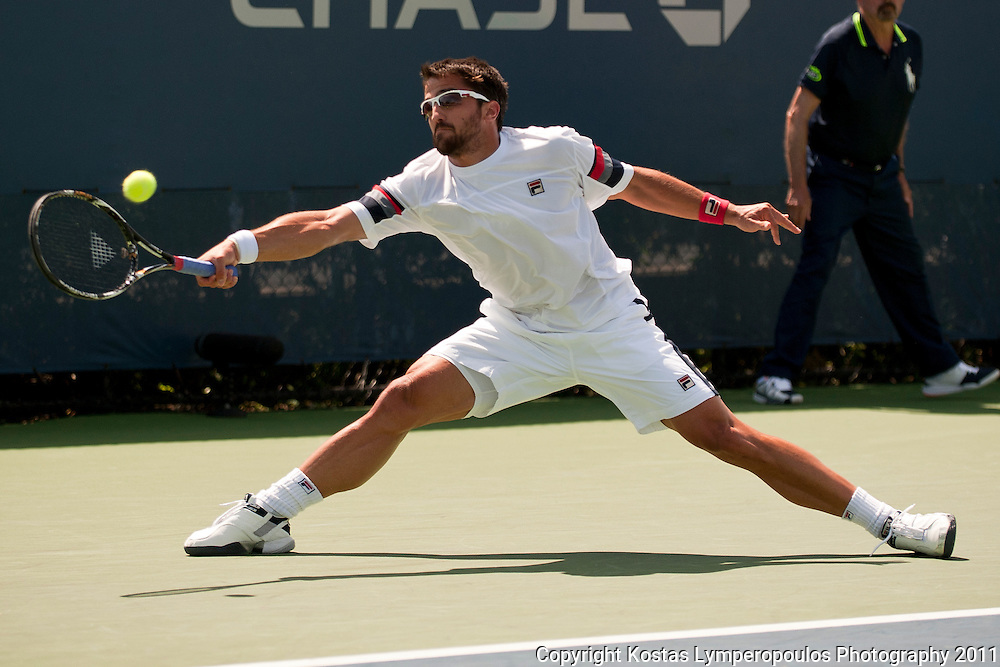 Sep 8, 2011; New York, NY, USA; Janko Tipsarevic (SRB) during his match against Phillipp Petzschner (GER) on day four of the 2011 US Open at Billie Jean King Tennis Center. Mandatory Credit: Kostas Lymperopoulos