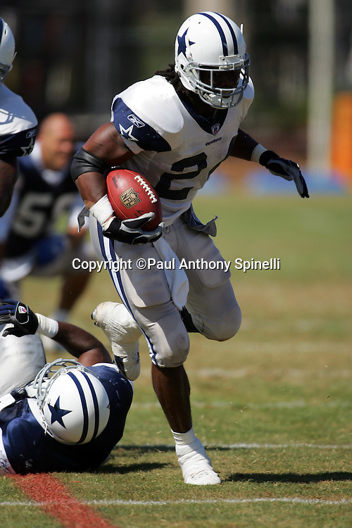 OXNARD, CA - AUGUST 9:  Running back Marion Barber #24 of the Dallas Cowboys runs the ball during the Dallas Cowboys training camp on August 9, 2006 in Oxnard, California. ©Paul Anthony Spinelli *** Local Caption *** Marion Barber