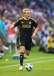 ZUG, SWITZERLAND - Wednesday, July 21, 2010: Liverpool's Steven Irwin in action against Grasshopper Club Zurich during the Reds' first preseason match of the 2010/2011 season at the Herti Stadium. (Pic by David Rawcliffe/Propaganda)
