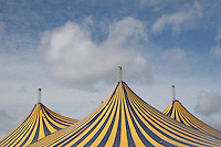 Stripped tops of festival tents