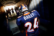 DENVER, CO - DECEMBER 18: Champ Bailey #24 of the Denver Broncos waits in the tunnel to be announced to the home crowd on December 18, 2011 at Sports Authority Field at Mile High in Denver, Colorado before facing the New England Patriots. The Broncos lost the game 41-23. Bailey has been the cornerstone of a solid Broncos' defense in 2011. (Photo by Marc Piscotty / © 2011)