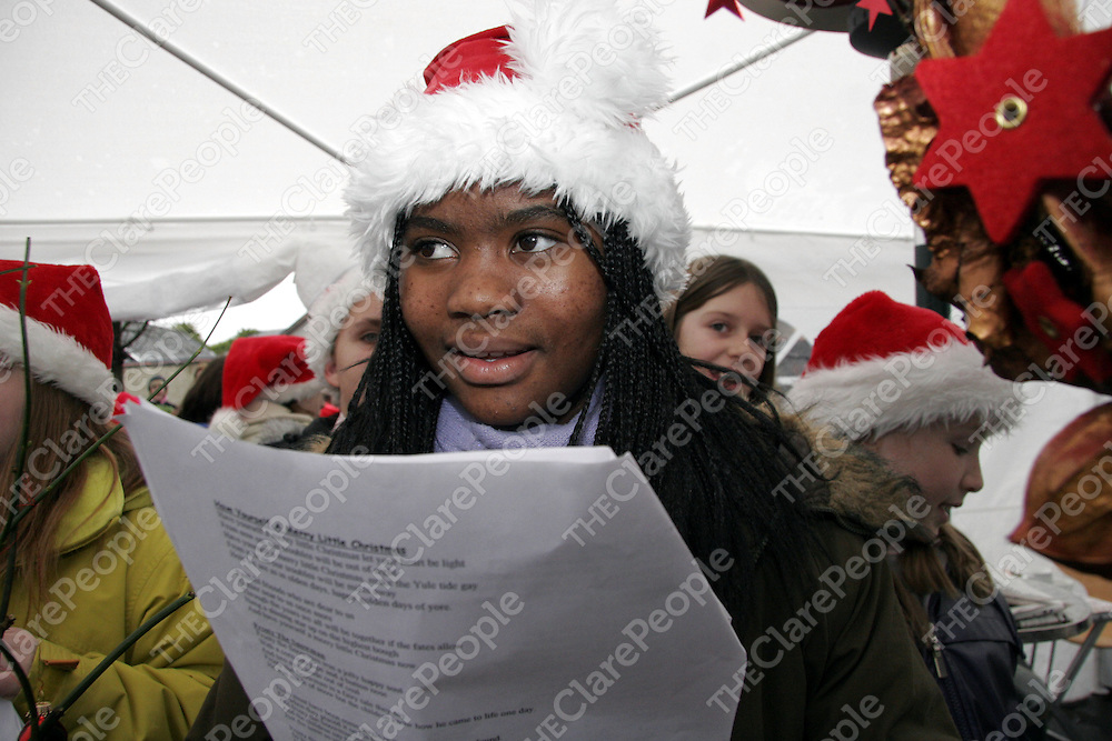 Holy Family student Vivienne Matha sang carols along with her clas mates at the Barrack Street Christmas party on Thursday.<br />