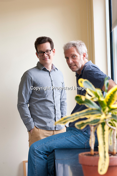 """Thomas Herndon (left) Graduate student at the University of Massachusetts in Amherst and Robert Pollin (right), Co-Director of the Political Economy Research Institute at University of Massachusetts in Amherst, pose for a portrait in the Gordon Hall building in the UMass campus in Amherst, Massachusetts on June 26, 2013. Herndon and Pollin wrote an article that critiques and finds flaws in Reingart's and Rogoff's """"Growth in a Time of Debt"""" article."""