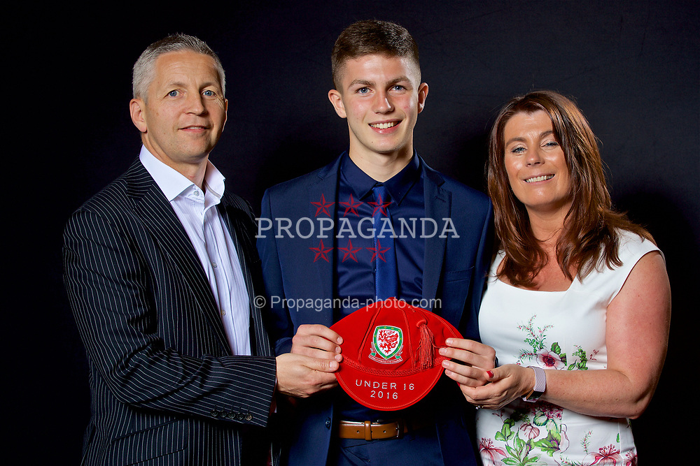 NEWPORT, WALES - Saturday, May 27, 2017: Bailey Owen and his family with his Under-16 Wales cap at the Celtic Manor Resort. (Pic by David Rawcliffe/Propaganda)