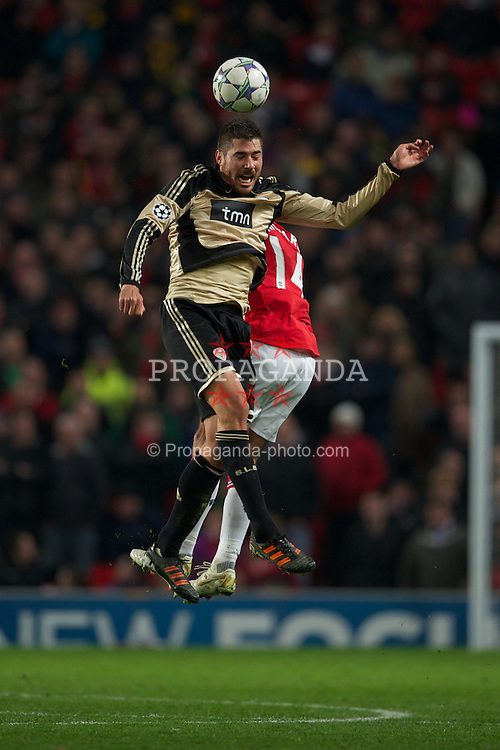 MANCHESTER, ENGLAND - Tuesday, November 22, 2011: SL Benfica's Javi Garcia in action against Manchester United during the UEFA Champions League Group C match at Old Trafford. (Pic by David Rawcliffe/Propaganda)