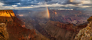 Rainbow and spot lighting in the Grand Canyon in the early morning following a storm, from Lipan Point. © 2018 David A. Ponton