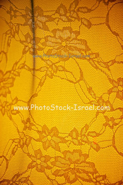 close up of a Brownish backlit lace floral design