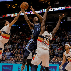 Jan 7, 2019; New Orleans, LA, USA; Memphis Grizzlies forward Jaren Jackson Jr. (13) shoots over New Orleans Pelicans forward Julius Randle (30) and forward Anthony Davis (23) during the second quarter at the Smoothie King Center. Mandatory Credit: Derick E. Hingle-USA TODAY Sports