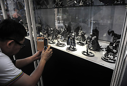 A Man takes a photo of Batman toys  during the exhibition in conjunction with Batman's 75th anniversary in a shopping mall in Kuala Lumpur on Jun 02, 2014. The Batman 75th Anniversary celebration Malaysia is from 28 May 2014 & will run till 15 June 2014, Monday, 2nd June 2014. Picture by Mohd FIrdaus / i-Images