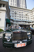 Hong Kong, Kowloon. Rolls Royce limousines for guests at the Peninsula hotel.