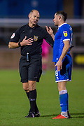 Referee Andy Haines speaks with Mike Jones (#8) of Carlisle United FC during the The FA Cup match between Carlisle United and Forest Green Rovers at Brunton Park, Carlisle, England on 10 December 2019.