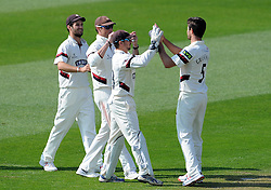 Somerset's Tim Groenewald celebrates the wicket of Lancashire's Ashwell Prince with team mates.. - Photo mandatory by-line: Harry Trump/JMP - Mobile: 07966 386802 - 08/04/15 - SPORT - CRICKET - Pre Season - Somerset v Lancashire - Day 2 - The County Ground, Taunton, England.