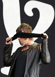 © licensed to London News Pictures . 30/06/2012 . Manchester , UK . Beady Eye , fronted by Liam Gallagher , perform on stage at Heaton Park . Liam Gallagher wraps a piece f black cloth over his eyes as he walks across the stage during his performance . The band are playing as warm up for the Stone Roses , who are on their comeback tour . Photo credit : Joel Goodman/LNP