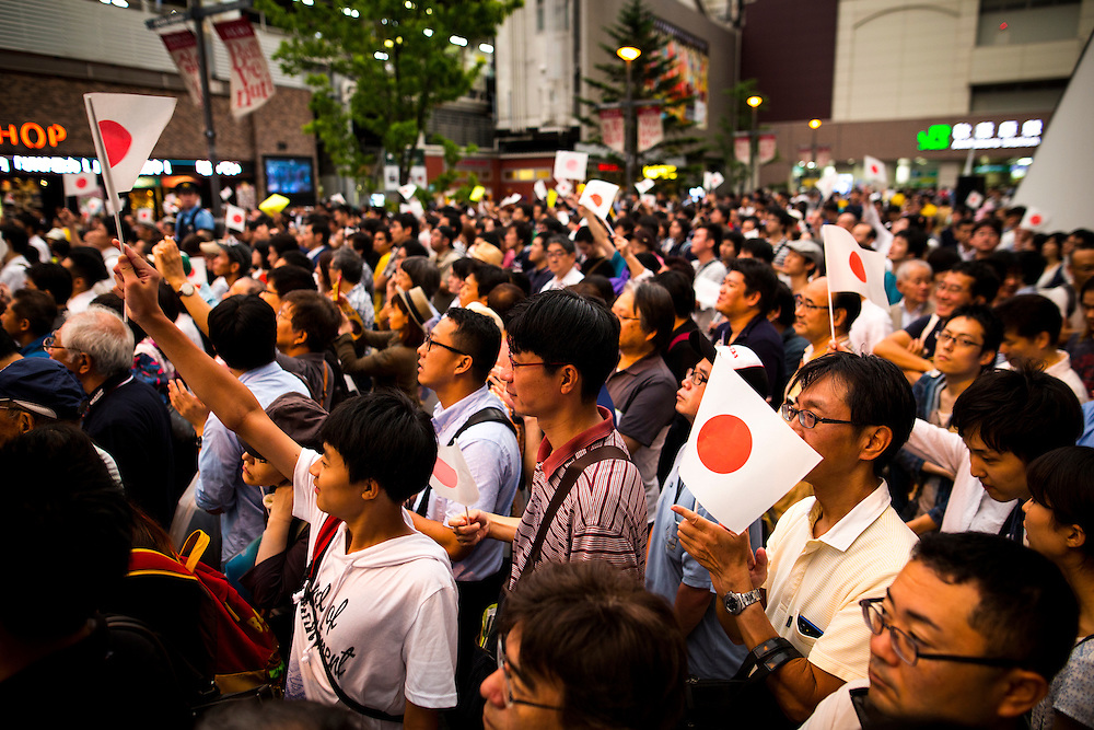 TOKYO, JAPAN - JULY 9 :  Japanese flag being wave by supporters of Japanese Prime Minister Shinzo Abe and the ruling Liberal Democratic Party (LDP) during the last day of the Upper House election campaign outside of Akihabara Station in Tokyo, Japan on July 9, 2016. Tomorrow, July 10, 2016 will be the first Upper house election nation-wide in Japan that 18 years old can vote after government law changes its voting age from 20 years old to 18 years old. (Photo by Richard Atrero de Guzman/NURPhoto)