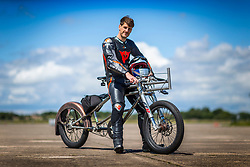 © Licensed to London News Pictures. 01/07/2019. York UK. Neil Campbell, the European cycling speed record holder has been testing his £15,000 custom built Moss bicycle complete with stopping parachute at Elvington airfield in Yorkshire ahead of an attempt to break the 167mph world cycling record later this year. Neil is towed up to speed behind a Porsche Cayenne before he is released & peddles on to his top speed. Photo credit: Andrew McCaren/LNP