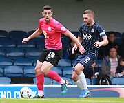Peterborough United player Joe Gormley shields the ball from Southend player John White during the Sky Bet League 1 match between Southend United and Peterborough United at Roots Hall, Southend, England on 5 September 2015. Photo by Bennett Dean.