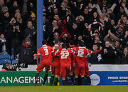 Leyton Orient players celebrate in front of the travelling fans after Leyton Orient Midfielder Jobi McAnuff makes it 1-0 during the Sky Bet League 2 match between Portsmouth and Leyton Orient at Fratton Park, Portsmouth, England on 6 February 2016. Photo by Adam Rivers.