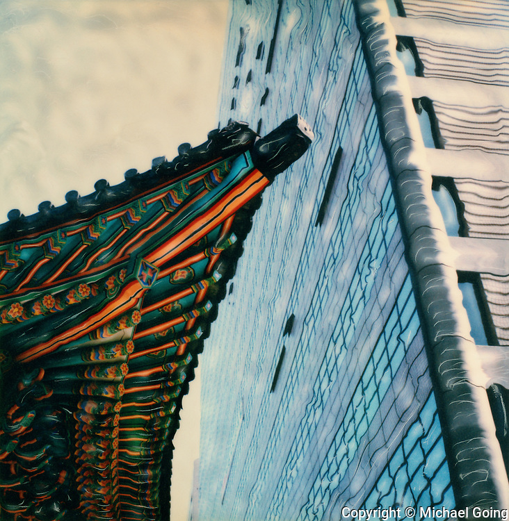 hand altered Polaroid SX-70 of a pagoda and modern office building in downtown Seoul Korea
