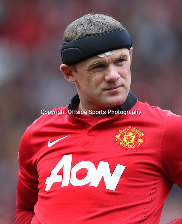 14th September 2013 - Barclays Premier League - Manchester United v Crystal Palace - Wayne Rooney of Man Utd wears a protective headband - Photo: Simon Stacpoole / Offside.