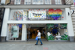 © Licensed to London News Pictures. 01/07/2019. LONDON, UK.  A Three store on Oxford Street is one of many retail stores in the capital's West End whose exteriors are decorated in rainbow colours in support of Pride Month.  Pride is an annual celebration of the LGBT+ community and culminates in the LGBT+ parade in the UK, with thousands of people travelling the route either by foot or on floats.  Photo credit: Stephen Chung/LNP