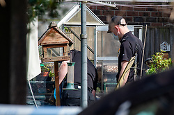 © Licensed to London News Pictures. 21/05/2020. Beaconsfield, UK. Specialist search team members search through a greenhouse at a property on North Drive. Thames Valley Police were called to North Drive, Beaconsfield at around 00:01 BST on Thursday 21/05/2020 to a report of a stabbing. A man in his forties had sustained injuries consistent with stab wounds and was taken to hospital. Photo credit: Peter Manning/LNP