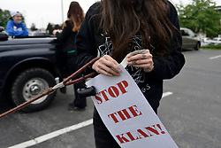 Members of a protest caravan of local activist mount protest signs at a parking lot, ahead of a drive back country roads in Lancaster County, PA, on May 20, 2017 to protest the plans of a cross lighting of a Maryland based Ku Klux Klan chapter in QuarryVille, PA.