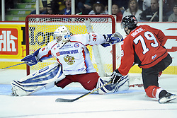 T.J. Brodie of the Barrie Colts takes a shot on Russian goaltender Alexander Zalivin in Game 4 of the CHL's SUBWAY Super Series in Windsor, ON on Monday. Photo by Aaron Bell/OHL Images.