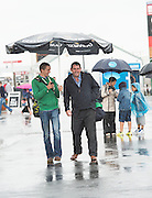 01/08/2014 A very Large Umbrella for A very wet Galway race track in Ballybrit for the Friday evening of the Galway races  .Photo:Andrew Downes