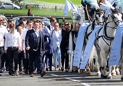 © Licensed to London News Pictures. 21/08/2018. Epsom, UK. Paddy Doherty (blue suit) walks next to the horse drawn hearse carrying the coffin of his nephew Mikey Connors at Epsom cemetery. 32 year-old Mikey Connors, the nephew of My Big Fat Gypsy Wedding star Paddy Doherty, was killed when his horse-and-cart was hit by a car in Thamesmead on July 28. Photo credit: Peter Macdiarmid/LNP