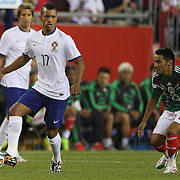 Nani, (left), Portugal, marked by José Vázquez, Mexico, during the Portugal V Mexico International Friendly match in preparation for the 2014 FIFA World Cup in Brazil. Gillette Stadium, Boston (Foxborough), Massachusetts, USA. 6th June 2014. Photo Tim Clayton
