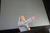 Young woman having presentation at conference