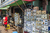 YANGON, MYANMAR - CIRCA DECEMBER 2013: Merchant selling transformers in the Yangon street market.
