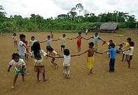 Achuar Indian kids play a game in the village of Pumpuentsa, in Ecuador's Amazonian jungle. (Photo/Scott Dalton)