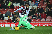 Aston Villa attacker Jonathan Kodjia (26) with shot on goal during the EFL Sky Bet Championship match between Brentford and Aston Villa at Griffin Park, London, England on 31 January 2017. Photo by Matthew Redman.