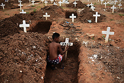 November 2, 2018 - Rio De Janeiro, Brazil - A boy cleans graves in the Caju Cemetery, North zone of the city during the day of the dead. (Credit Image: © Fabio Teixeira/ZUMA Wire)