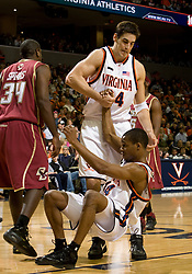Virginia forward/center Ryan Pettinella (34) helps Virginia guard Sean Singletary (44) off the court.  The Virginia Cavaliers men's basketball team defeated the Boston College Golden Eagles 84-66 at the John Paul Jones Arena in Charlottesville, VA on January 19, 2008.