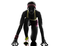 one  woman runner running on starting blocks in silhouette on white background