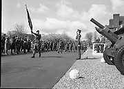 1983-04-12.12th April 1983..Photographed at McKee Barracks, Cork..Marching Past..Battalion marching past Defence Minister Paddy Cooney. ..Lieutenant Martin Murphy of Cork bears the new regimental flag...Lieutenant Thomas McGrath  leads the marching troops.