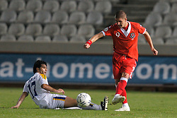 Nicosia, Cyprus - Saturday, October 13, 2007: Wales' Carl Robinson and Cyprus' Marinos Satsias during the Group D UEFA Euro 2008 Qualifying match at the New GSP Stadium in Nicosia. (Photo by David Rawcliffe/Propaganda)