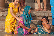 Women bathing in the holy river Ganges at Varanasi, Uttar Pradesh. India