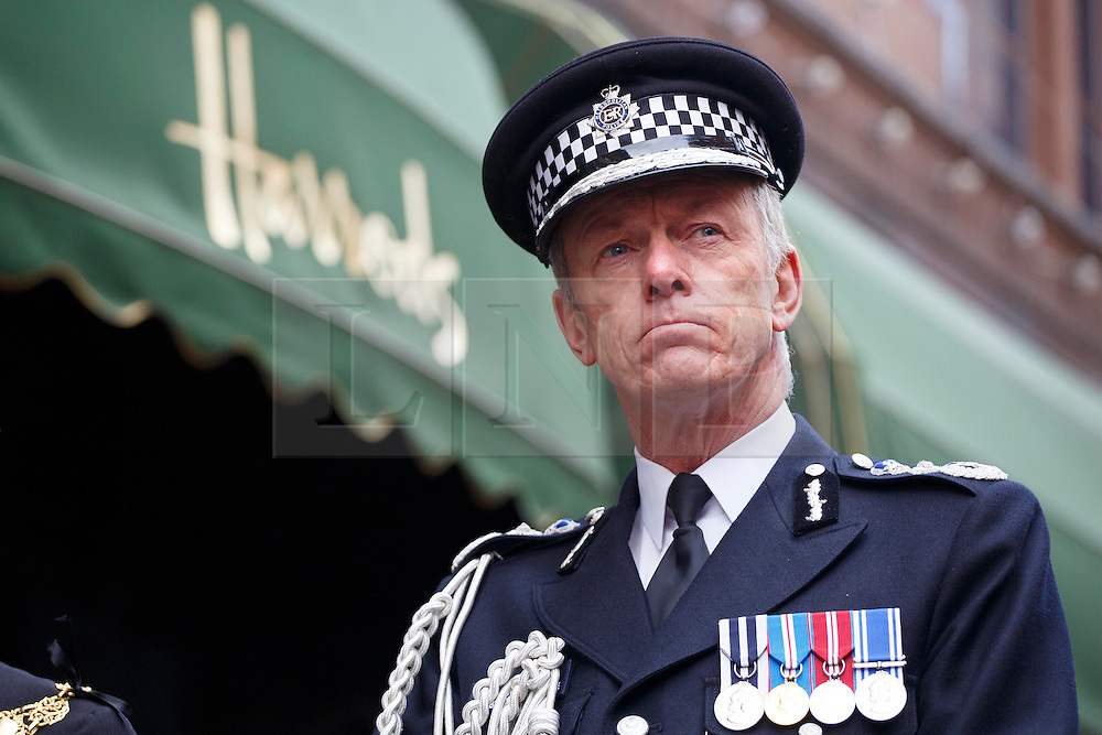 © licensed to London News Pictures. London, UK 17/12/2013. Sir Bernard Hogan-Howe attends a ceremony to commemorate an IRA bomb attack on Harrods which killed six people, including three Metropolitan Police officers on December 17, 1983. The 30th anniversary is marked by members of Metropolitan Police, relatives and friends of victims and Harrods staff at a special service outside the world-famous department store in London on Tuesday, December 17, 2013. Photo credit: Tolga Akmen/LNP