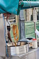 Churro street seller in Old Havana, Cuba.