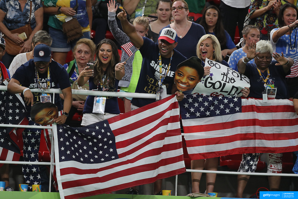 Gymnastics - Olympics: Day 4  United States fans celebrate victory during the Artistic Gymnastics Women's Team Final at the Rio Olympic Arena on August 9, 2016 in Rio de Janeiro, Brazil. (Photo by Tim Clayton/Corbis via Getty Images)