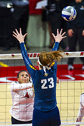 BLOOMINGTON, IL - September 15:  Kaylee Martin soft touches the ball over Elizabeth Orf during a college Women's volleyball match between the ISU Redbirds and the Marquette Golden Eagles on September 15 2019 at Illinois State University in Normal, IL. (Photo by Alan Look)