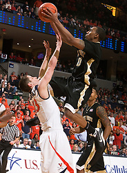 Wake Forest guard Jeff Teague (0) draws a blocking foul from Virginia guard Sammy Zeglinski (13).  The Virginia Cavaliers fell to the #13 ranked Wake Forest Demon Deacons 70-60 at the John Paul Jones Arena on the Grounds of the University of Virginia in Charlottesville, VA on February 28, 2009.