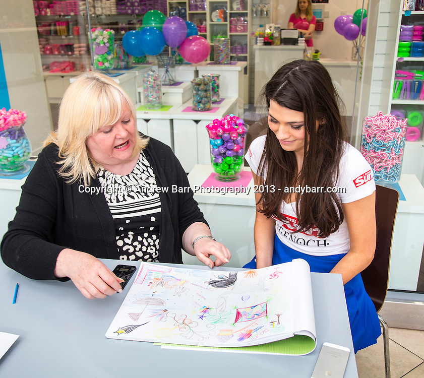 19:05:2013..Miss Scotland 2013 -  The 10 finalists have this doodles analysed by Sun Psychic Joan Charles...Mhairi with Joan...Pic:Andy Barr..07974 923919  (mobile).andy_snap@mac.com..All pictures copyright Andrew Barr Photography. ..Please contact before any syndication. .