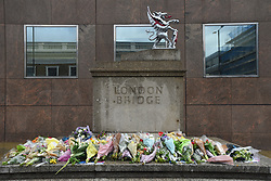 Flowers are pictured at the south-side of London Bridge in London on June 6, 2017, placed in memory of the victims of the June 3 terror attacks. Police on Monday identified two of the three London attackers as Khuram Butt and Rachid Redouane, after Britain's third terror assault in less than three months, as Prime Minister Theresa May came under mounting pressure over security just days ahead of elections. (Photo by Alberto Pezzali/NurPhoto) *** Please Use Credit from Credit Field ***